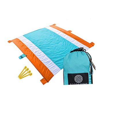 Best oversized beach blanket! Material is wipeable and comes with stakes so it stays in place. Awesome reviews!